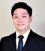 講師の賀長 哲也 先生の顔写真